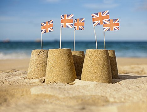 Sandcastles with Union Jack flags --- Image by © Seb Oliver/cultura/Corbis